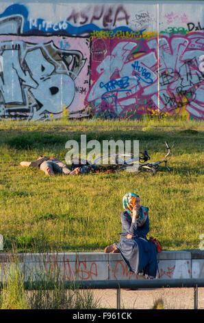 Turkish woman on the River Spree Berlin, Germany - Stock Photo