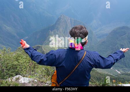 Travellers at the high vantage point of Montana Machu Picchu, Peru - Stock Photo