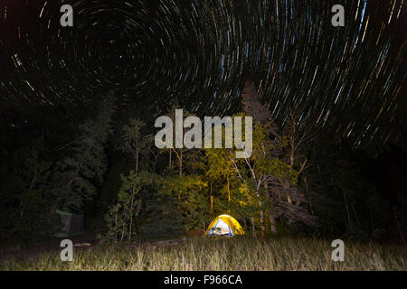 Star trails over a Lake Superior campsite in Lake Superior Provincial Park, Ontario, Canada (image stacking) - Stock Photo