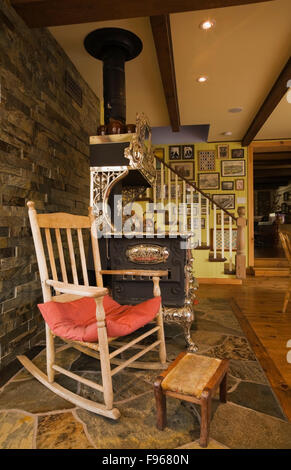 Antique Rocking Chair And Wood Stove In Front Of The Fireplace In The Stock Photo 91729814 Alamy