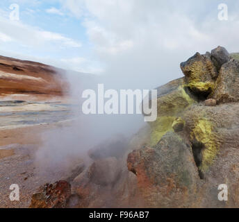 Geothermal hot springs, Hverarond, Namaskard, Iceland. The area is characterized by boiling mud-bogs and solfataras. - Stock Photo