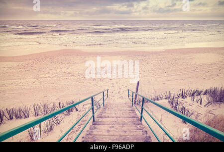 Vintage toned wooden stairs on a beach. - Stock Photo