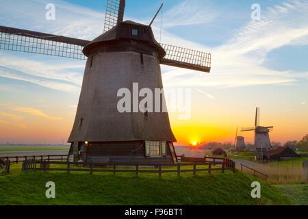 Windmills at Sunset, Schermerhorn, North Holland, Netherlands - Stock Photo