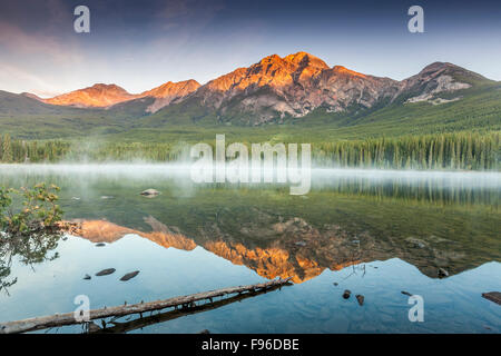 Pyramid Mountain reflected in Pyramid Lake, Jasper National Park, Alberta, Canada - Stock Photo