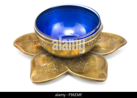 Antique brass pot with blue glass isolated on white - Stock Photo