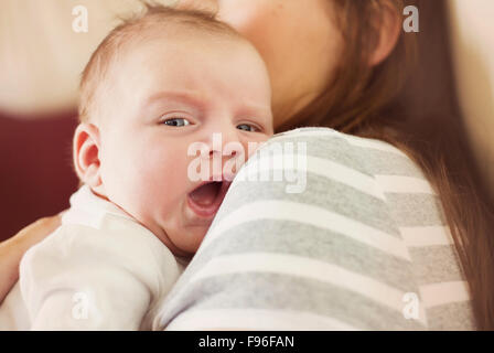 Cute newborn baby boy relaxing at home with his mother - Stock Photo