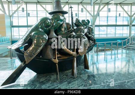 THE SPIRIT OF HAIDA GWAII, THE JADE CANOE, by artist BILL REID, HAIDA at the Vancouver International airport - Stock Photo