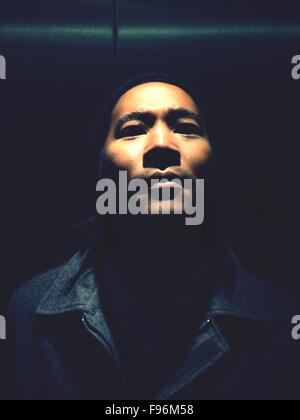 Close-Up Portrait Of Serious Young Man - Stock Photo