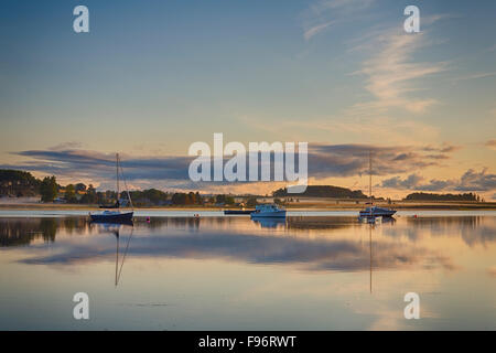 Sailboats and motorboats reflected in the West River, Meadowbank, Prince Edward Island, Canada - Stock Photo