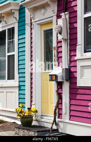 Harmonious colours on the facades of two rowhouses in the historic district of St. John's, Newfoundland. The residences - Stock Photo