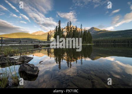 Pyramid Island and Pyramid Mountain reflecting on Pyramid Lake at sunrise. Jasper National Park, Alberta, Canada. - Stock Photo