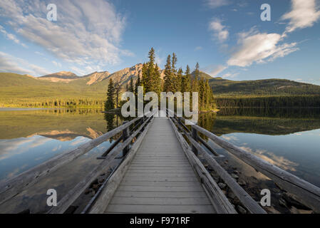 Bridge to Pyramid Island over Pyramid Lake with Pyramid Mountain in background. Jasper National Park, Alberta, Canada. - Stock Photo