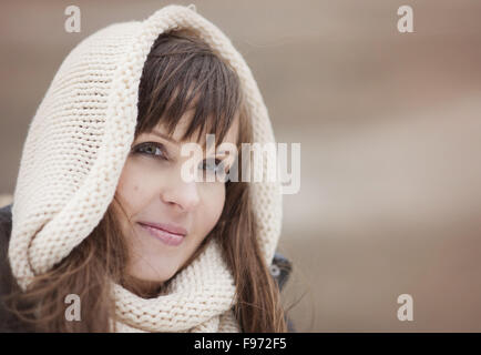 Portrait of woman with hood on in autumn country - Stock Photo