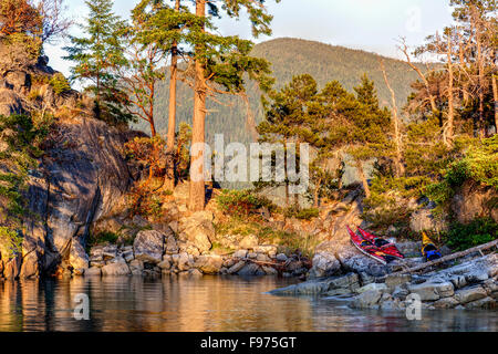High tide separates East Curme from West Curme Island in Desolation Sound Marine Park. British Columbia, Canada. - Stock Photo