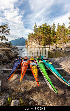 Kayaks rest just above the high tide mark on West Curme Island in Desolation Sound Marine Park. British Columbia, - Stock Photo