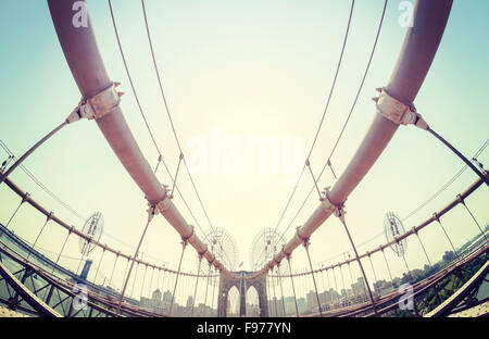 Vintage toned fisheye lens picture of the Brooklyn Bridge in New York City, USA. - Stock Photo