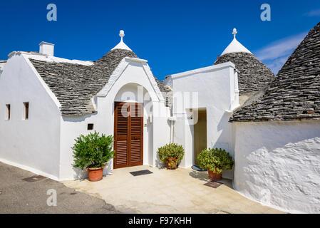 Alberobello, Italy, Puglia. Unique Trulli houses with conical roofs. Trullo, trulli, a traditional Apulian dry stone - Stock Photo