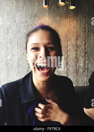 Close-Up Portrait Of Happy Young Woman - Stock Photo