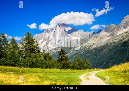 Mont Blanc, France. Summer scennery with amazing Aiguille du Midi conic mountain in Chamonix Haute-Savoie region - Stock Photo