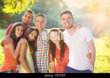 Group of young people having fun in park - Stock Photo