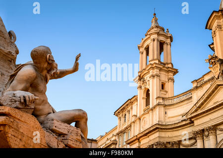 Piazza Navona in Rome with detail of Fountain of the four Rivers (Fontana dei Quattro Fiumi) and Sant Agnese in - Stock Photo