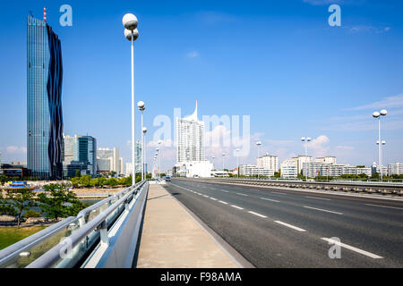 Danube City Vienna with Reichsbruecke (Empire Bridge) and the brand new DC-Tower tallest skyscraper in Austria. - Stock Photo