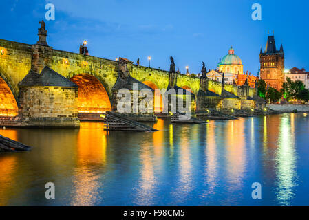 Prague, Czech Republic. Charles Bridge and Mala Strana towers, with Prague Castle (Hrad) in background twilight - Stock Photo