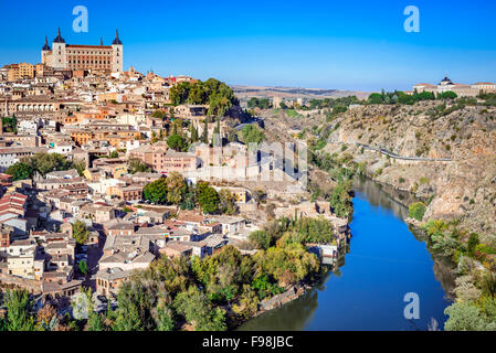 Toledo, Spain. Alcazar and the ancient city on a hill over the Tagus River, Castilla la Mancha medieval attraction - Stock Photo