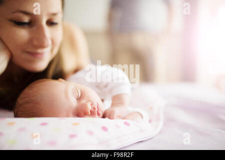 Happy mother with baby girl inside of room. - Stock Photo
