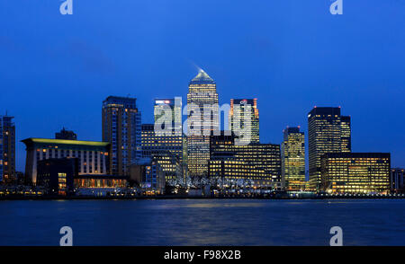 Skyline view of Canary Wharf with HQs from HSBC, Credit Suisse, Citi and JP Morgan alongside Canada Tower at dusk, - Stock Photo