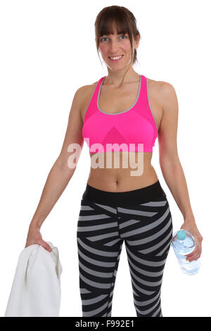 Young fitness woman bottle water and towel at sports workout training isolated on a white background - Stock Photo