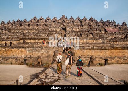YOGYAKARTA, INDONESIA - AUGUST 22, 2015: Borobudur complex, a 9th-century Mahayana Buddhist Temple in Magelang, - Stock Photo