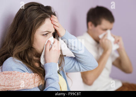 Sick woman and man have cold, flu and high fever. - Stock Photo