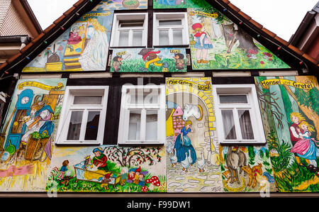 Painted house in the fairy tale town Steinau an der Straße, with scenes from the brothers Jacob and Wilhelm Grimm - Stock Photo