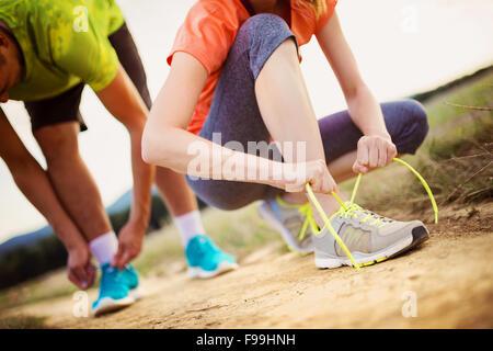 Runner feet. Running couple closeup of running shoes. - Stock Photo