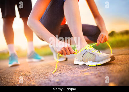 Runner feet. Running couple closeup of running shoes. - Stock Photo