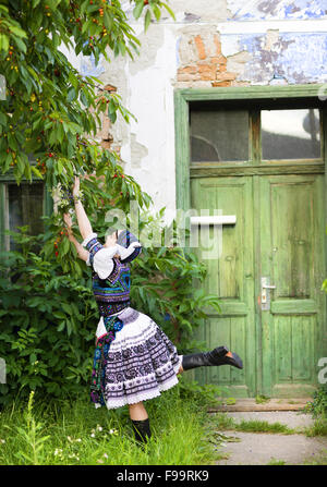 Beautiful woman wearing traditional Eastern Europe folk costumes. - Stock Photo