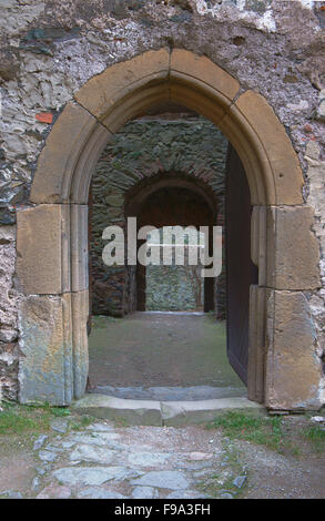 The gate in the wall of a medieval castle in Poland - Stock Photo