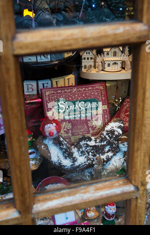 Santa Claus, The book of secrets in amongst a christmas shop display window at Bourton on the Water, Cotswolds, - Stock Photo