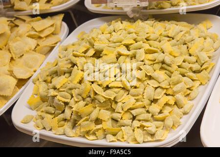 Fresh homemade Italian pasta ravioli on platter - Stock Photo