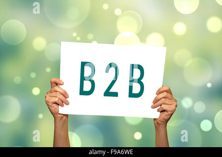 B2B (marketing) card in hand with abstract light background. Selective focus. - Stock Photo