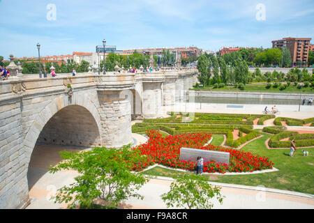 Toledo bridge and Madrid Rio park. Madrid, Spain. - Stock Photo