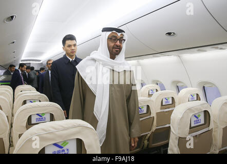 Shanghai, China. 15th Dec, 2015. Mohammed Bin Zayed Al Nahyan (front), crown prince of Abu Dhabi Emirate of the - Stock Photo