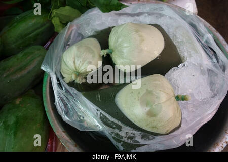 Gotu kola or centella juice for sale in bags on a stall in a Bangkok wet food market, Thailand - Stock Photo