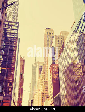 Vintage stylized photo of skyscrapers in Manhattan, New York City, USA. - Stock Photo