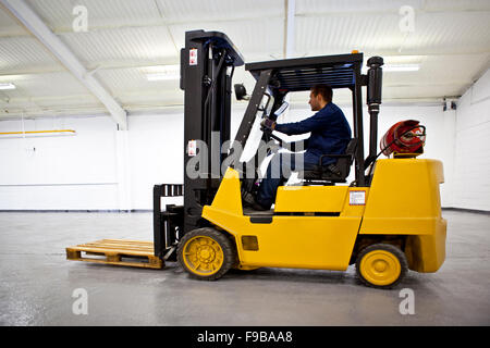 Fork Lift Truck in Warehouse - Stock Photo