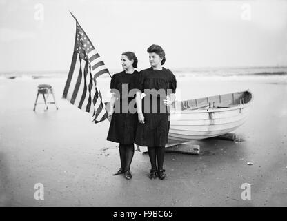 Portrait of Two Young Women with American Flag and Row Boat on Beach, Atlantic City, New Jersey, USA, 1900