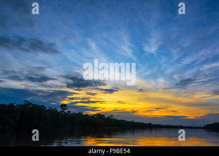 Beautiful sunset over the Javari River in the Amazon rain forest in Brazil - Stock Photo