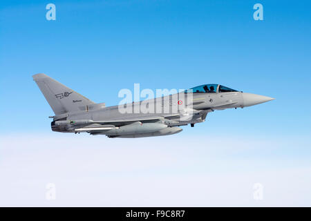 An Italian Air Force F-2000A Typhoon flying over the Tyrrhenian Sea during an air-to-air refueling operation. - Stock Photo