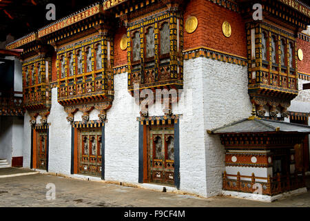 Richly ornated windows and bay windows in the monastery and fortress Punakha Dzong, Punakah, Bhutan - Stock Photo